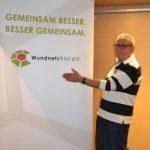 Beiratsmitglied Eric Grundner vor unserem Werbebanner
